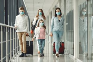 People in airport are wearing masks to protect themselves from virus