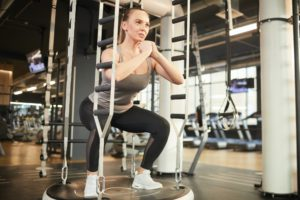 Young Woman Squatting in Gym